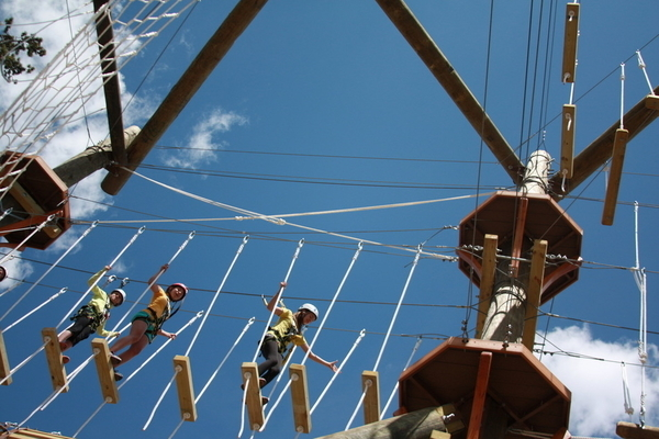 Zipline group having fun on self-belay.